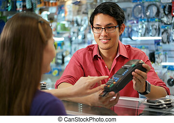 Customer Paying With Credit Card In Chinese Computer Shop -...