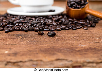 cafe beans and coffee cup