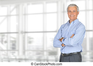 Casual Businessman Arms Folded - A smiling casually dressed...