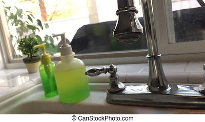 Slow Motion Turning Off Faucet - Slow Motion of Hand Turning...