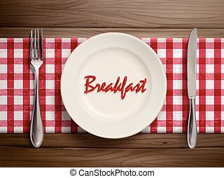 breakfast word written by ketchup on a plate - top view of...