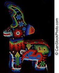 Mexican huichol deer artcraft on black background