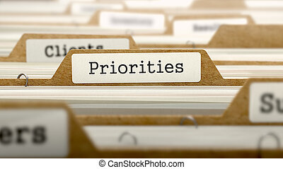 Priorities Concept with Word on Folder. - Priorities...