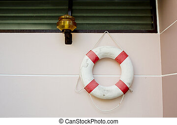 life vest on white wall