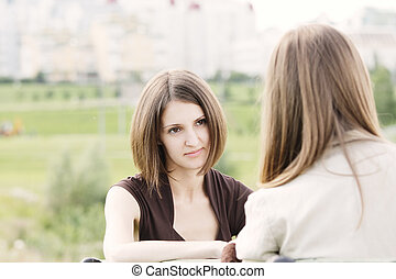 Attentive listener participating in two women conversation...