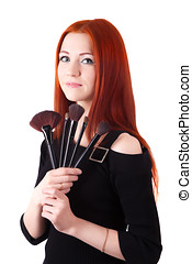 Girl makeup artist with brushes