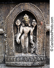 Stone statue of a Hindu God on a public temple