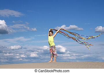 little girl playing summer scene