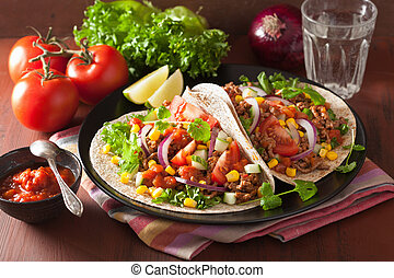 mexican tacos with beef tomato salasa onion corn