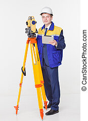surveyor isolated - Worker looking into the level white...