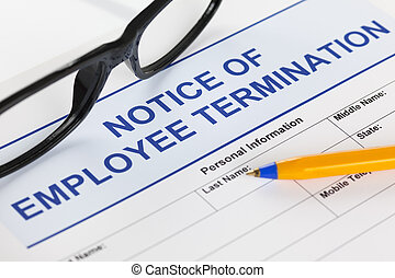 Notice of employee termination with glasses and ballpoint...