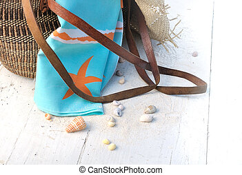 towel in beach bag - towel in a beach bag on white plank...