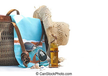 beach bag and accessories on white background  with shells
