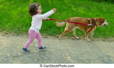 Child Little Girl Running With Dog - Happy people, family...
