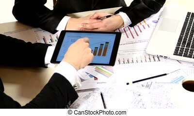 Businessmen consider drawing on the tablet and contract,...