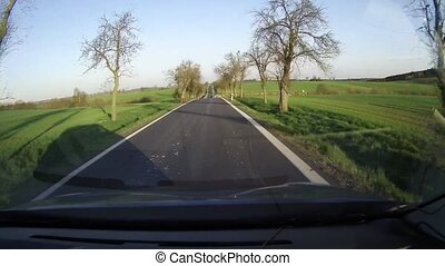 Car dashboard record - Driving the country road outside of...