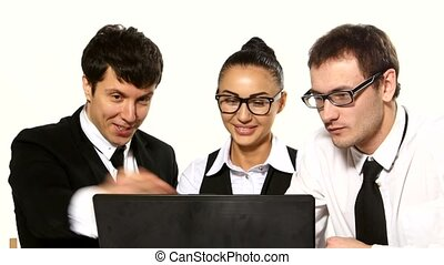 Business team cheerfully talking. laptop in front of them -...