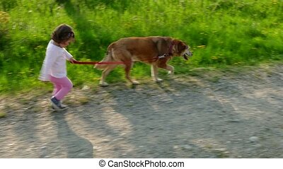 Happy Girl Having Fun Walking Dog