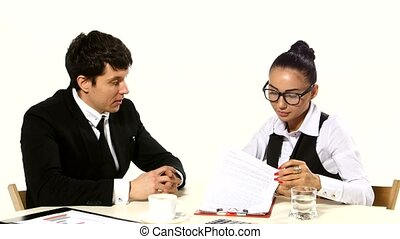 Businessman and businesswoman sign a contract, after reading the papers, shake hands