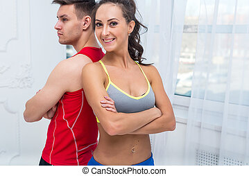 sporty couple friends slim athletic ambitious woman and...