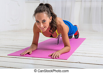fitness training athletic sporty woman doing plank exercise...