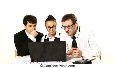 Business team looking at laptop in anticipation completion...