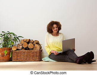 Middle aged woman using laptop at home
