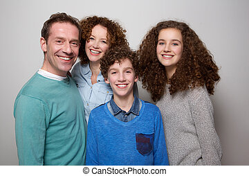 Happy family smiling together - Portrait of a happy family...