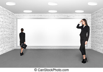 Businesswomen indoors with empty display