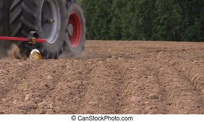 field soil fertilization - Soil earth and tractor...