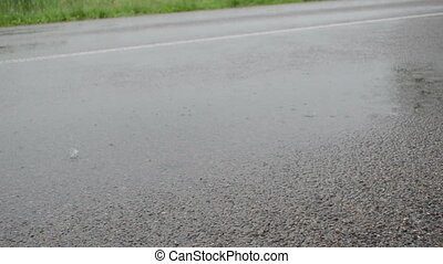 asphalt rainfall water - Closeup of asphalt road and strong...