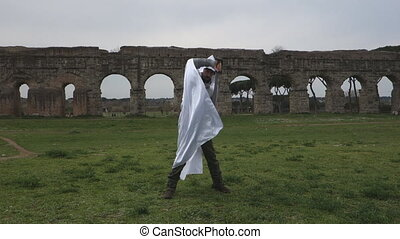 knight - Male Medieval knight under ancient Roman ruins and...