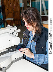 Industrial sewing machines with sewing machine operator -...