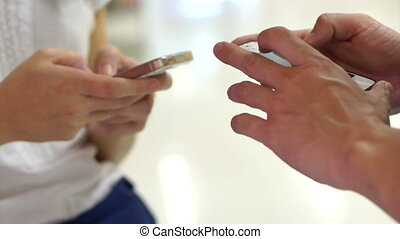 two people using smart phone - two people using touchscreen...