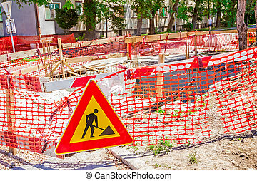 We are working - Construction site is protected by several...