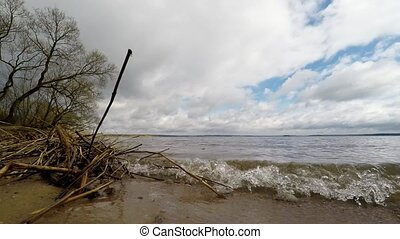 waves on sandy beach. The beach on the shores of Lake
