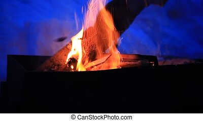Camp fire burning at night in winter with sound - Camp fire...
