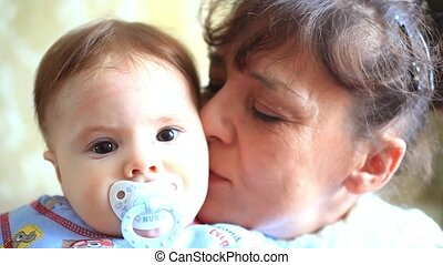 happy grandma kisses her grandson - happy grandma with...