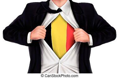 businessman showing Belgium flag underneath his shirt over...