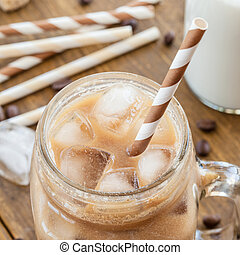 Iced coffee in vintage jar - Iced coffee with milk in...