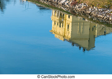 building reflected in water