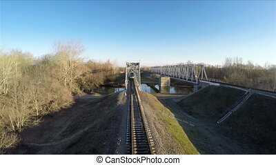 Train goes over the bridge - Passenger train goes over the...