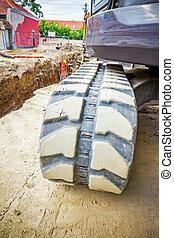 Excavator crawler belt close up in construction site