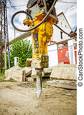 Hydraulic hammer - Excavator has attached hydraulic plug-in...