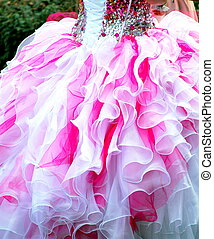 Quinceanera ceremony - Quinceanera formal gown by a female...