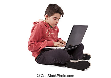 child with computer isolated on white
