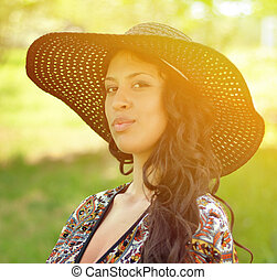 Portrait of beautiful attractive woman with straw hat