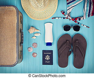 A collection of travel items including suitcase, passport,...