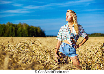 Young american cowgirl woman portrait outdoors