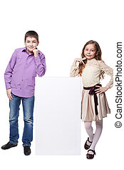 Little girl and boy beside a blank. Isolated on white background